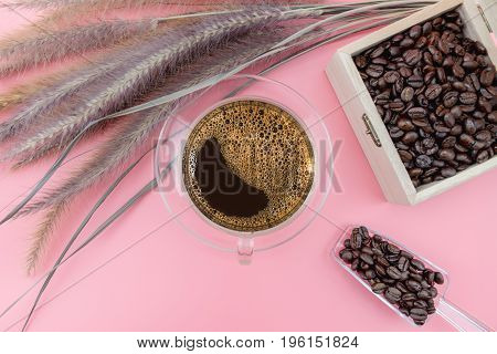 Coffee Cup And Coffee Beans On Pink Background