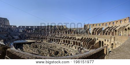 ROME ITALY - 22 JUNE 2017 - The impressive Roman architecture of the Colosseum amphitheatre in Rome with its many stone arches and columns