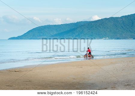 Kid Boy Driving Bicycle In The Beach