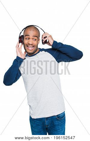 Confused African American Man Listening Music In Headphones Isolated On White
