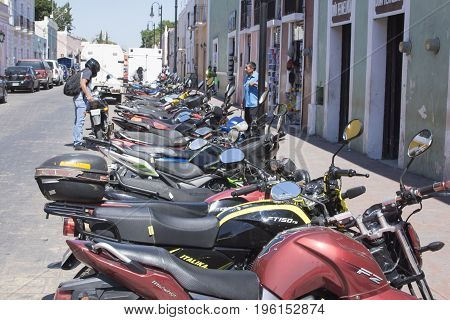 VALLADOLID YUCATAN MEXICO - FEBRUARY 24 2017: Inexpensive motorbikes are the personal means of transportation choosen by many citizens in Mexico