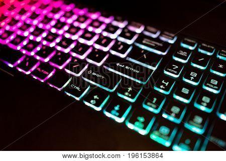 Closeup Of Colorful Illuminated Keyboard At Night