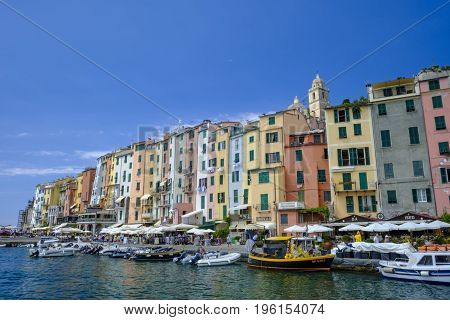 PORTO VENERE ITALY - 18 JUNE 2017 - Summer scene of colorful seafront buildings and variety of boats in pretty seaside town of Porto Venere a UNESCO World Heritage Site