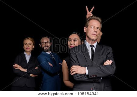 Confident Multiethnic Group Of Mature Businesspeople Standing With Crossed Arms And Joking Isolated