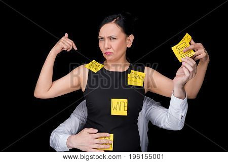 Overworked Mature Asian Businesswoman With Sticky Notes On Clothes Pointing At Herself While Colleag