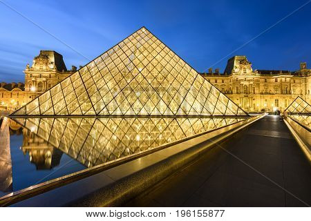 Paris - June 04 2017 : Louvre museum at dusk on June 04 2017 in Paris. This is one of the most popular tourist destinations in France displayed over 60000 square meters of exhibition space