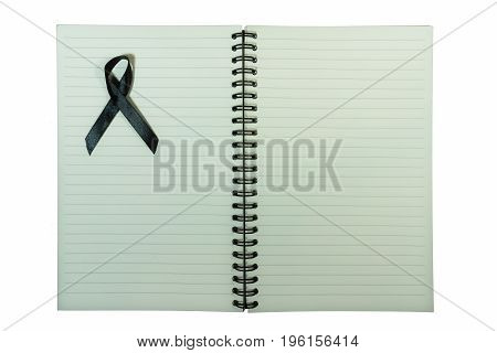 Notebook with black ribbon isolated on white background. Concept image : funeral, sad mood, tragedy concept.