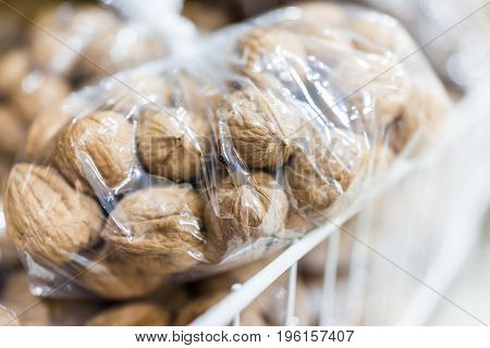 Raw Unshelled Walnuts In Plastic Bags For Sale