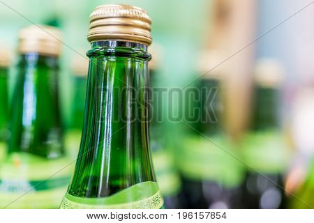 Tops Of Many Green Apple Glass Bottles On Display
