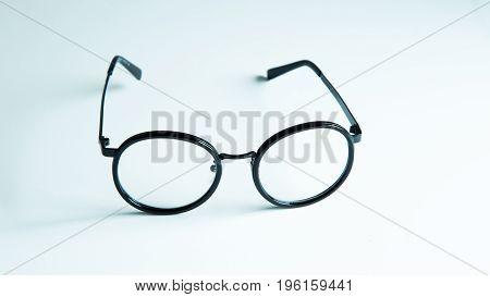 Black retro nerd glasses on white background (eyeglasses)