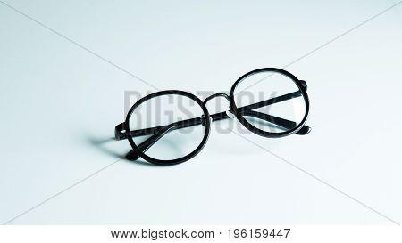 Black vintage glasses on white background, fashion