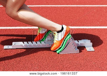 A female high school sprinter is in the