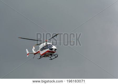 Rescue helicopter rushing to the rescue, in sky