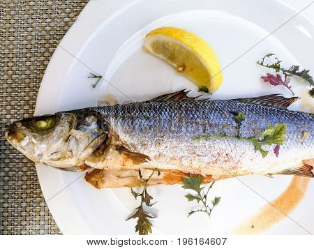 delicious plate of sea bass and lemon