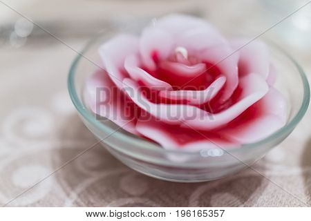Rose Flower Candle In Glass Bowl On Table