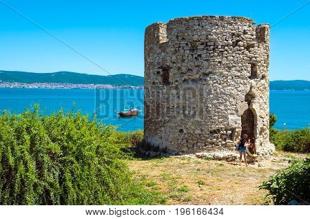 NESSEBAR BULGARIA - JULY 3 2014: The old watchtower of the ancient Bulgarian town Nessebar on the background of the resorts Sunny Beach and Saint Vlas.