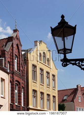 Street view of traditional houses in high street in Leer, Germany.