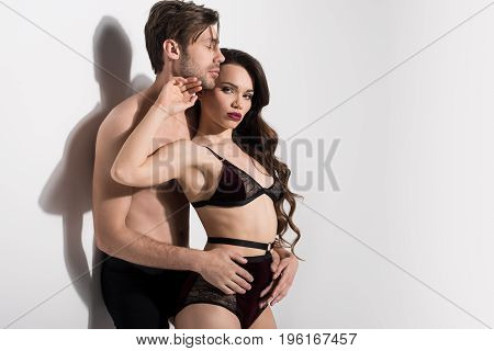 Beautiful Seductive Couple Hugging And Posing On White Background