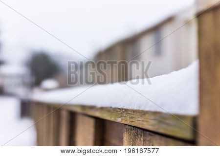Heavy Snow Piled On Fence Railing In Backyard