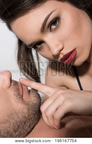 Portrait Of Beautiful Sensual Couple, Woman Looking At Camera And Touching Mans Lips