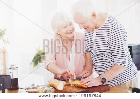 Senior Couple Cutting Bread