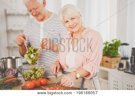 Senior Man And Woman Preparing Food