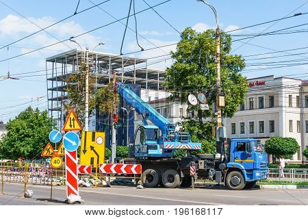 Voronezh, Russia - July 15, 2017: Repair of the road and underground water pipelines in the center of Voronezh city, Russia. Road signs, repairs are made