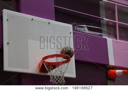 Street basketball bright purple colour ball net no people closeup