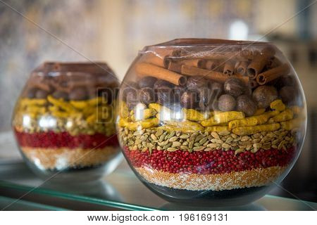 Spices In Jars On Glass Deck In The Kitchen