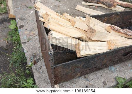chopped wood in mangal. Ready for fire.