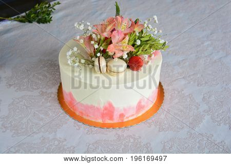 small white wedding cake decorated with flowers