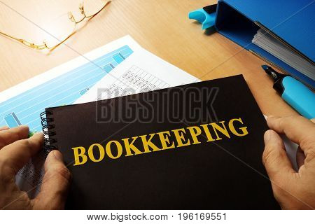 Bookkeeping written on a front of note.