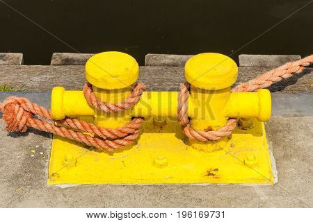 Sailing Ropes Tied Around Pins In Sunlight