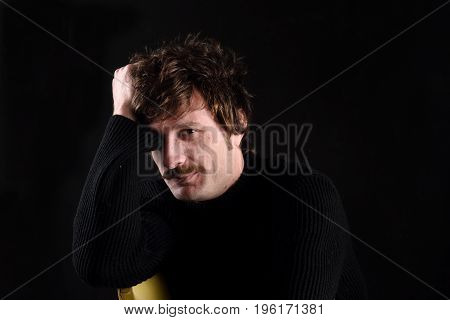 Portrait Of An Attractive Man On Black Background