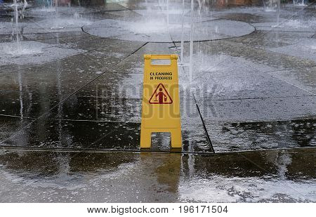 Yellow Caution slippery wet floor sign with clipping path.Sign showing warning of caution wet floor.