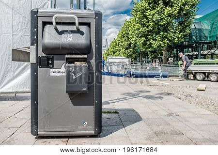HAMBURG , GERMANY - JULY 14 2017 : The city dustbin is collecting bottles, cans, garbage and cigarettes in the city of Hamburg