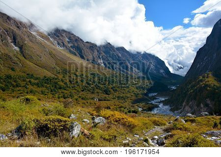 View of the valley covered with clouds on the way from Ghunsa to Lhonak trek to Kangchenjunga base camp Nepal