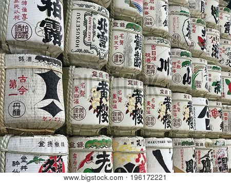 Japan Tokyo - July 16 2017: Close up of multiple stacked Sake barrels in front of Meiji Jingu shrine.