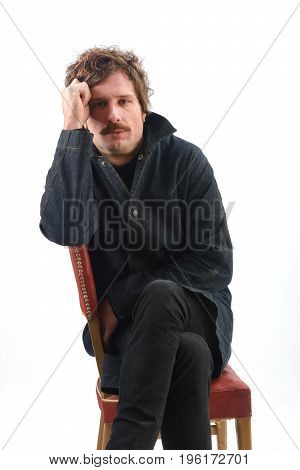 Portrait Of A Man Sitting On A Chair
