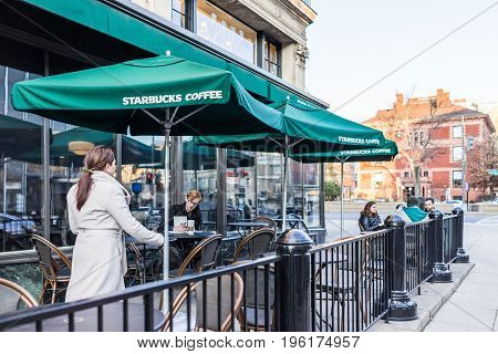 Washington Dc, Usa - February 5, 2017: Woman At Starbucks Walking Outside By Tables And Chairs
