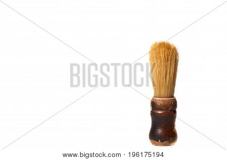 Old vintage shaving brush, isolated on white background.
