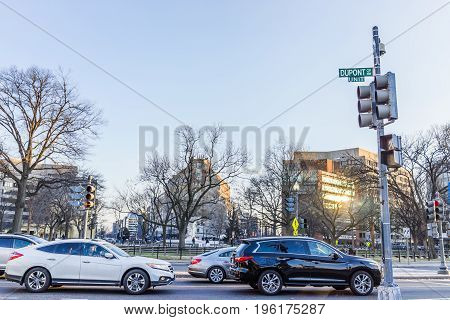 Washington DC USA - February 5 2017: Dupont circle with street sign and cars in winter