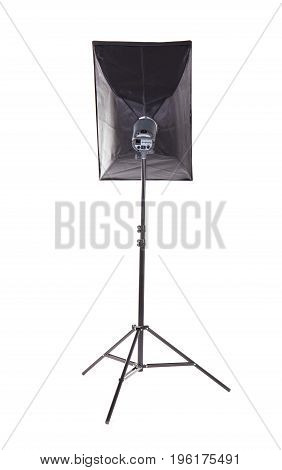 Lighting device on a tripod, isolated on a white background. Photo studio with lighting equipment. Profession studio flash with soft-box. Studio lighting. Pulse studio flashes with a square softbox.