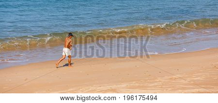 Saint-jean De Luze, France - Sept 28, 2016: Senior Man Running Shirtless In Swimsuit On A Beach At T