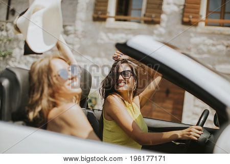 Pretty Young Women In White Cabriolet Car
