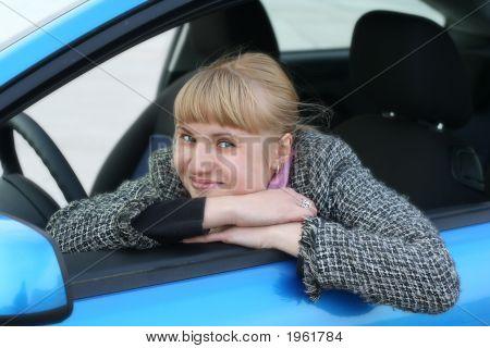 Blonde Girl In A Blue Car
