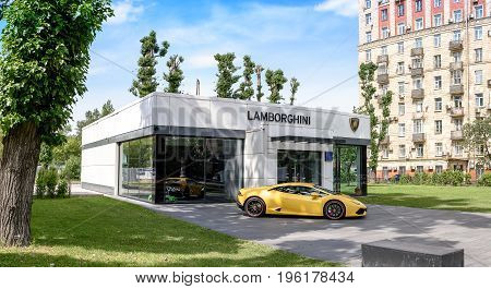 Russia, Moscow - June 30, 2017: Lamborghini Auto Show Next To A Yellow Lamborghini On A Beautiful Sk