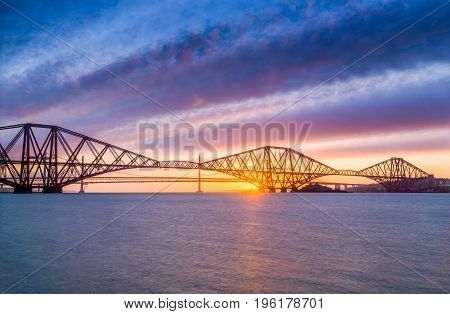 Long exposure of the Forth Rail bridge over the Firth of Forth in Scotland. Taken at sunset