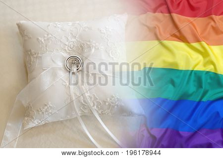 Wedding Rings With Rainbow Flag On A Pillow