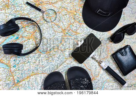 Travel plan, trip vacation accessories for trip, tourism mockup - Outfit of traveler on map background. Flat lay and copyspace. Still life